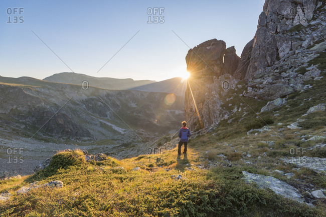 August 24, 2017: The last rays of sun disappear behind a rock face after a day of trekking in the Rila Mountains, Bulgaria, Europe