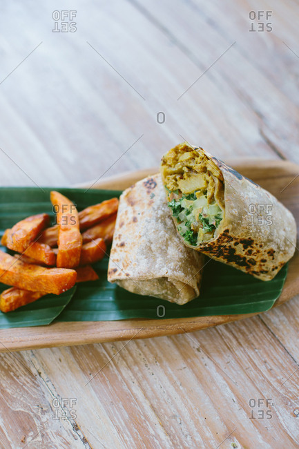 A chicken salad wrap with sweet potato fries from above