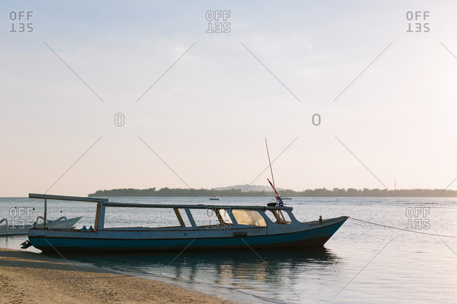Indonesian fishing boats docked on the beach
