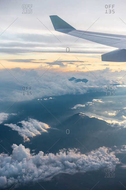 Airplane window view over Mount Agung, Bali Indonesia