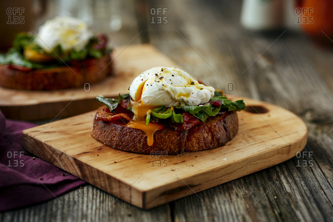 Open sandwich with collard greens and poached egg with yolk