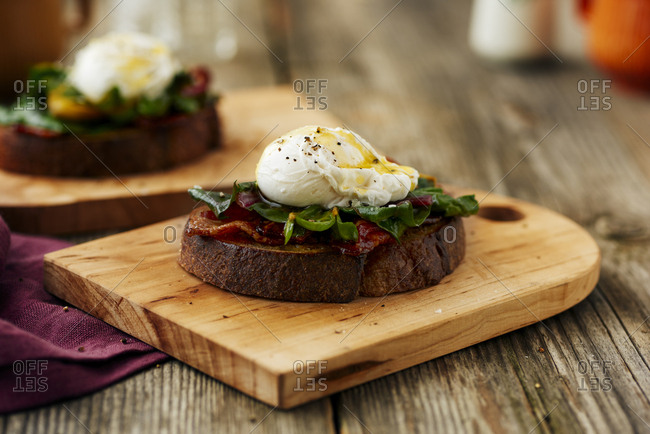 Open-faced sandwich with collard greens and poached egg