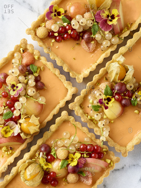 Tarts topped with berries and fruit