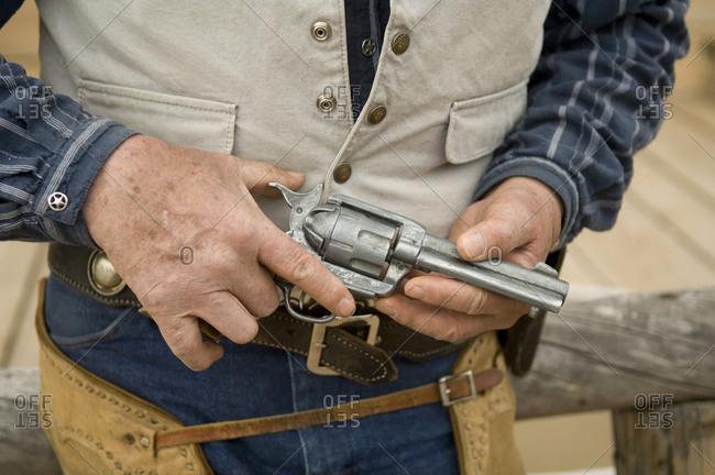 A close-up of a cowboy's gun at a movie ranch.