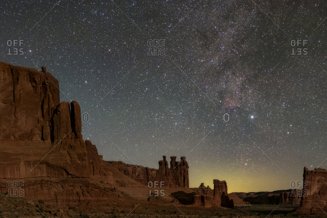 Moonlight on the Courthouse Towers with the Milky Way above the Three Gossips rock formation.