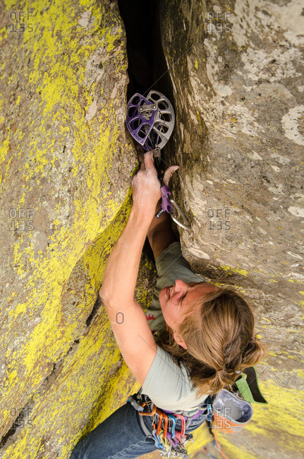 Williams, Arizona, USA - July 2, 2012: A female trad rock climber crack climbing at Sycamore Canyon.
