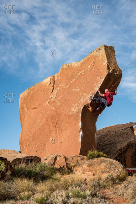 Bears Ears National Monument, Utah, USA - May 26, 2017: One male climber bouldering Air Wolf in Bears Ears National Monument.