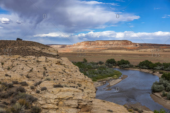 A single car overlooks the San Juan River as it flows through the dessert in Southern Utah.