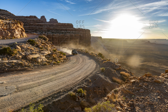 A four wheel drive sport utility vehicle drives up the Moki Dugway.