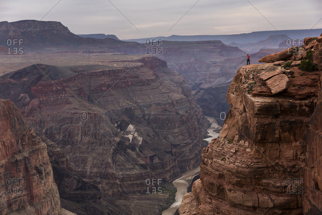 A man standing at Toroweap Point in the Grand Canyon.