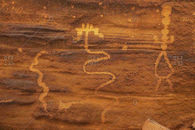 Cedar Mesa, Collins Canyon, Utah, USA - May 29, 2018: Abstract petroglyphs near Moss Back Butte.