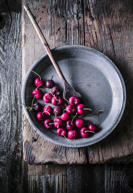 Cherries and wooden spoon still life