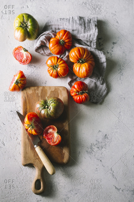 Heirloom tomatoes on a wooden cutting board