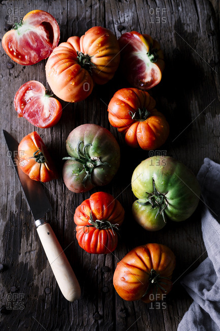 Heirloom tomatoes on a rustic cutting board