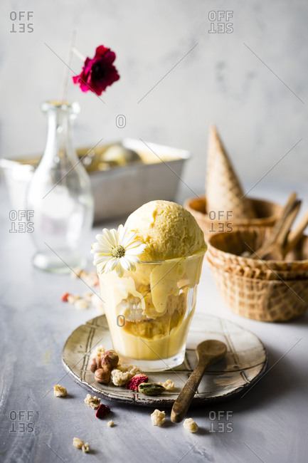 Beautifully served mango ice-cream with toppings