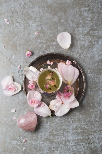 Rose blossom tea, rose quartz and rose petals