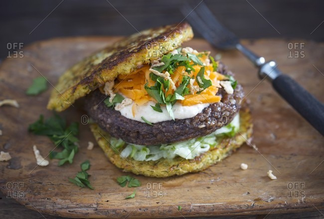 Vegan potato and turnip burgers, bean patties, date oat cream and a raw vegetable salad