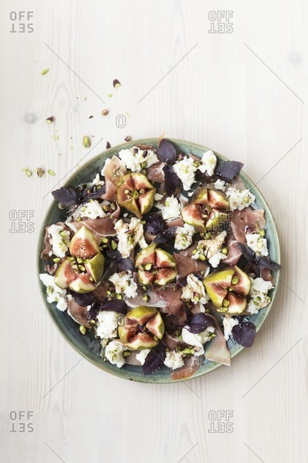 Fig prosciutto and mozzarella salad with purple basil and balsamic vinegar pistachio nuts