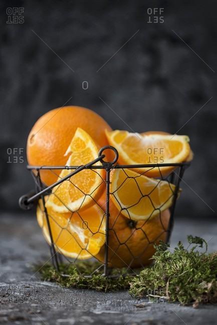 Oranges in a wire basket