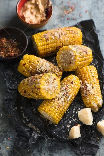 Grilled corn on the cob with herb butter and Parmesan