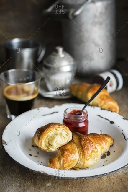 Homemade croissants with jam and coffee
