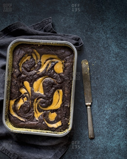 Gluten-free brownie and pumpkin cake in a baking tin