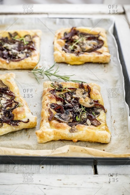 Pastries with caramelized onions, cheese and mushrooms