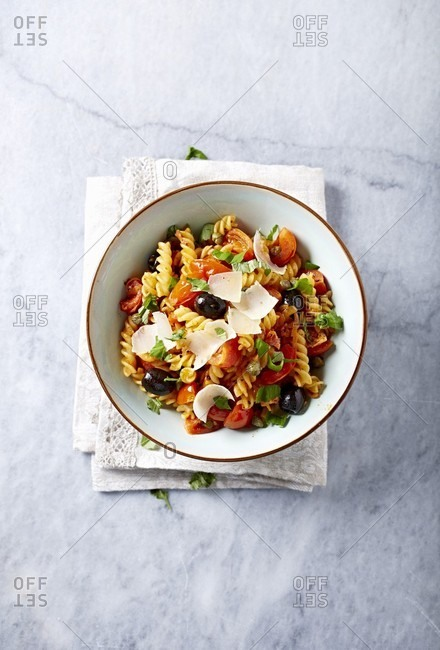 Pasta with pancetta, black olives and cherry tomatoes