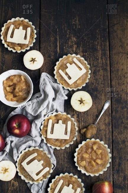 Unbaked apple tarts with a pastry pattern on the top