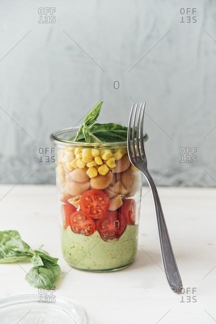 salad in a jar, avocado sauce (with garlic + basil), tomato, buckwheat + lentil pasta, corn, vegan