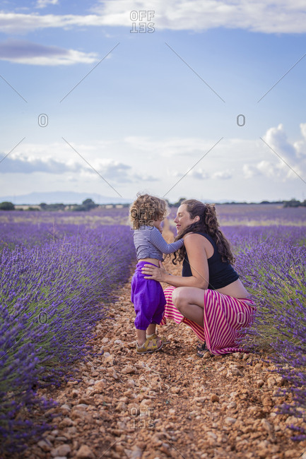 Pregnant woman with child in lavender field