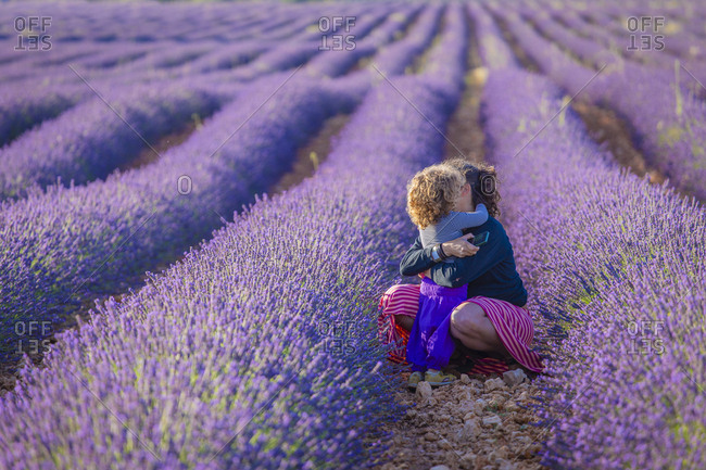 Woman with little girl in lavender field
