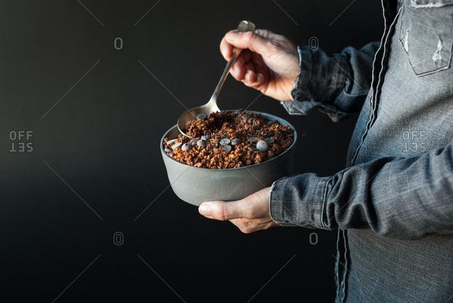 Man eating crunchy quinoa granola