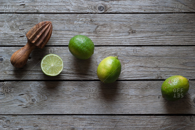 Delicious limes with manual citrus juicer