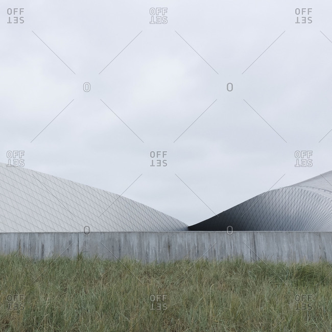 Architectural shot of a deserted barn on a field on a gloomy day