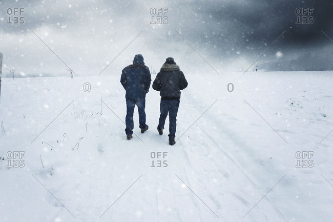 Two people in the snow during winter