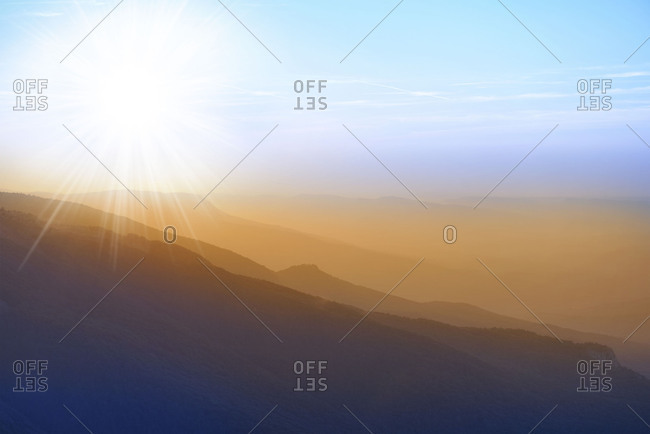 Beautiful scenic view of the mountains sunset