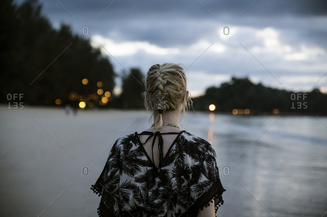 Thailand- Khao Lak- back view of woman on the beach at evening