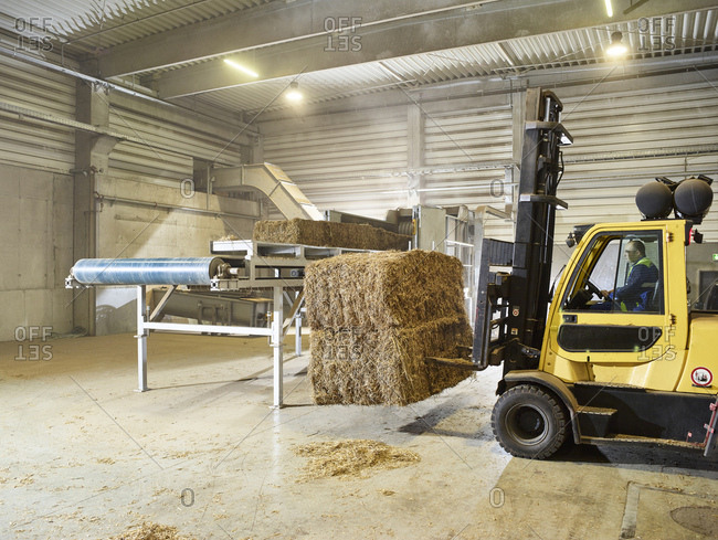 Rumania- woodworking- stacker truck with hay bales