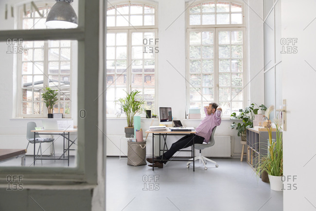 Man working at desk in a loft office