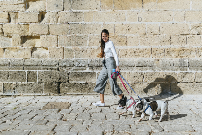 Young woman with her two dogs