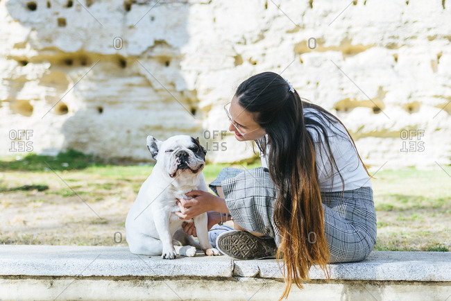 Woman talking to her dog outside