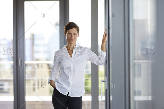 Portrait of confident businesswoman standing in office