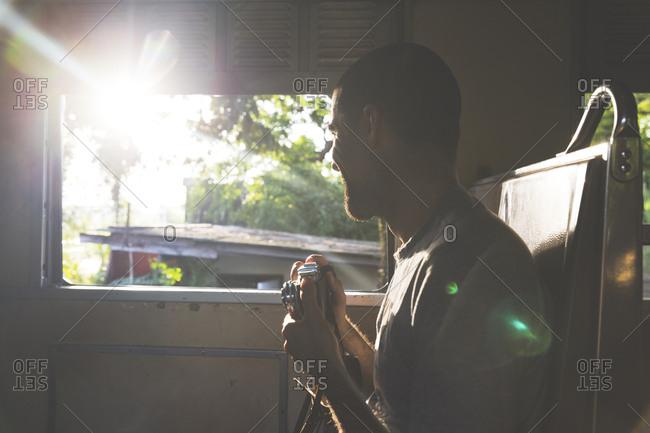 Thailand- Bangkok- tourist travelling- holding camera