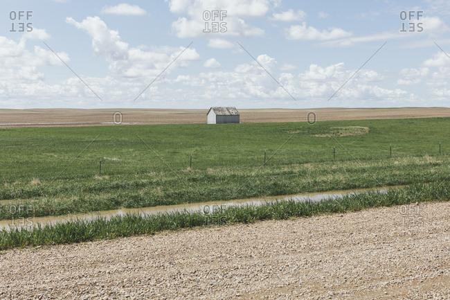 Small barn on vast open prairie, Saskatchewan, Canada