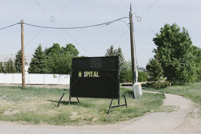Hospital sign on small town street