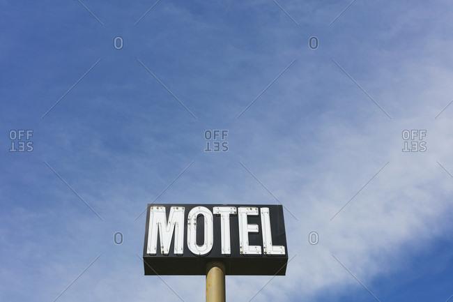 Motel sign against blue sky, near Maple Creek, Saskatchewan, Canada