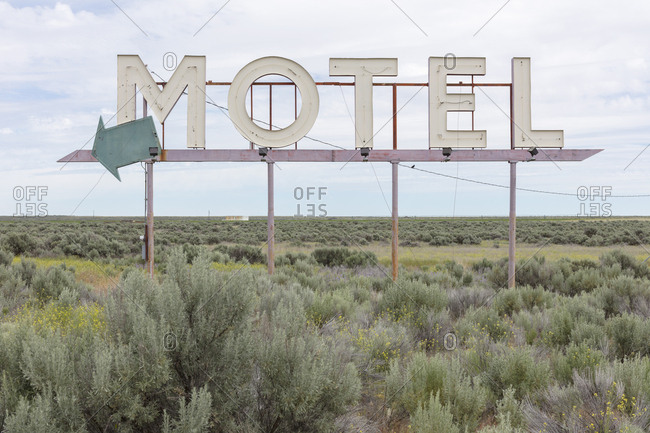 Motel sign in field of sage brush, near Waterville, Washington, USA