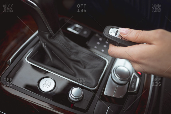 Close-up of female executive using car remote in a car