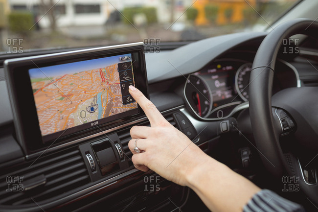 Close-up of Female executive using navigation in a car